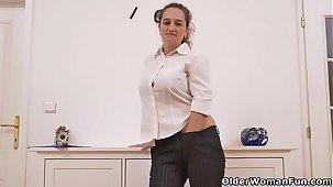 Euro milf Ameli stuffs her mature cunt with a dildo