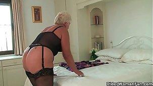Chubby granny in the air black stockings masturbates