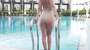 I'm wearing transparent swimsuit with regard to the public pool