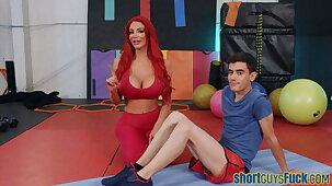 Redheaded busty MILF nailed apart from short guy at yoga