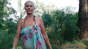 Lukerya takes off her bra relating to the forest